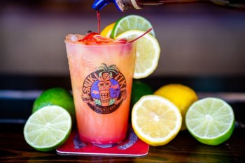Enjoy cocktails at the sniki tiki bar siesta key
